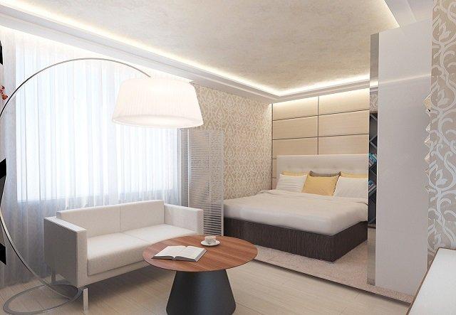со вкусом дизайн спальни совмещенной с гостиной
