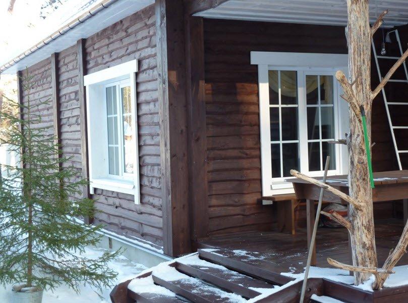 отделка дома фасадной доской фото