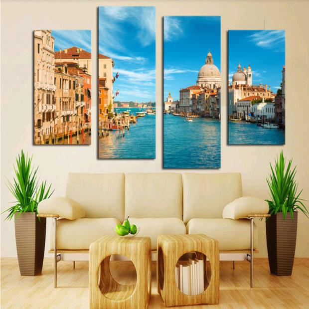 Гостиная в светлых тонах с диваном, журнальным столиком и модульными картинами на стене
