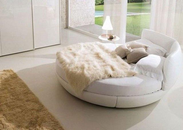 стильная спальня с круглой кроватью
