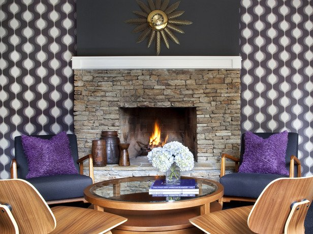 Rustic-stone-fireplace-with-modern-chair-also-glass-table-and-purple-pillows