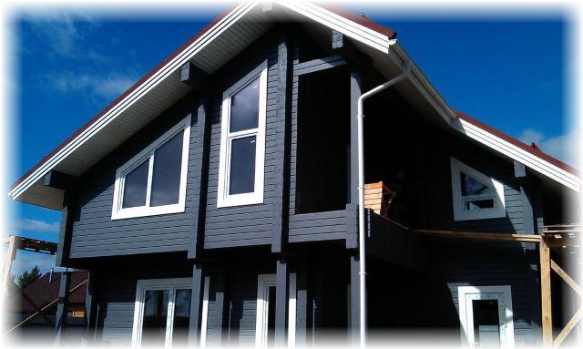 Покраска дома из клееного бруса